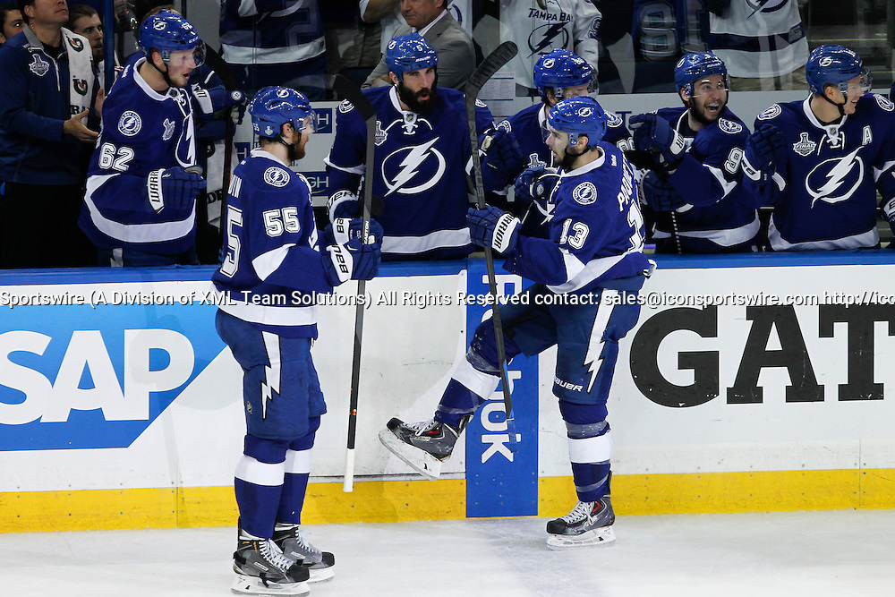 06 June 2015: Tampa Bay Lightning center Cedric Paquette (13) is congratulated by teammates on the Lightning bench after scoring a goal in the 1st period of  Game 2 of the Stanley Cup Finals between the Chicago Blackhawks and Tampa Bay Lightning at Amalie Arena in Tampa, FL.