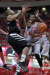 10 November 2014:  Ryan Jackson and Tony Wills get entangled going after a loose ball with Deontae Hawkins trying to add to the mix during an exhibition men's basketball game between Lewis University Flyers and the Illinois State Redbirds at Redbird Arena, Normal IL