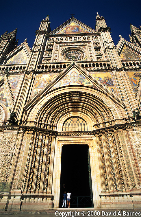 Couple in doorway of Duomo (Cathedral) in Orvieto;.Umbria; Italy