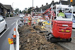 © Licensed to London News Pictures. 03/01/2013. 700 homes in the borough of Bromley,Kent are still without gas for a fifth day today (03.01.2013) after a burst water main in Locksbottom on Crofton Road (A232)  has wreaked havoc with the supply.  .Southern Gas Networks (SNG) has reconnected 950 of the 1,650 homes affected, having extracted 95,000 litres of water from gas pipes..The water main, located in Crofton Road, burst on Christmas Eve, causing water to leak into gas pipes..Local residents have been without gas since December 30..pic: Gas engineers working in Locksbottom to repair the burst water main..today.Photo credit : Grant Falvey/LNP