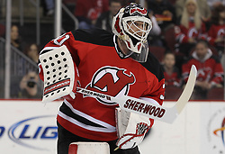 Mar 15; Newark, NJ, USA; New Jersey Devils goalie Martin Brodeur (30) plays the puck during the first period of their game against the Colorado Avalanche at the Prudential Center.