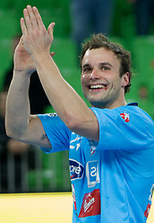 Uros Zorman of Slovenia celebrates after winning the handball match between National teams of Slovenia and Poland of Qualification Group 3 for Men's EURO 2012, on March 9, 2011 in Arena Stozice, Ljubljana, Slovenia. Slovenia defeated Poland 30-28. (Photo By Vid Ponikvar / Sportida.com)