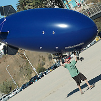 Kevin Corcoran, Vice President of GOBLIMPS.COM, retrieves his float Santa Monica Beach on Saturday, November 13, 2010.