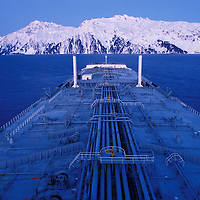USA, Alaska, Oil tanker sails through Prince William Sound on winter morning