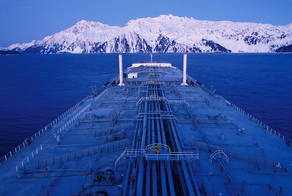 USA, Alaska, Oil tanker sails through Prince William Sound on winter morning