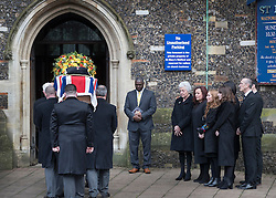 © Licensed to London News Pictures. 01/02/2017. Watford, UK. The family of former England football team manager Graham Taylor watch as his flag draped coffin arrives at St Mary's Church in Watford, Hertfordshire. The former England, Watford and Aston Villa manager,  who later went on to be chairman of Watford Football Club, died at the age of 72 from a suspected heart attack. Photo credit: Peter Macdiarmid/LNP