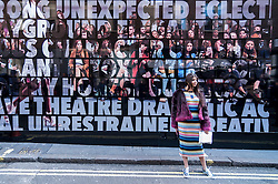 © Licensed to London News Pictures. 19/02/2016. London, UK.  Followers of fashion gather at the car park in Soho's Brewer Street for the opening of London Fashion Week SS16.  Some queue to attend the shows inside, others just want to be seen.  The choice of venue has been criticised for bringing disruption to the local area. Photo credit : Stephen Chung/LNP