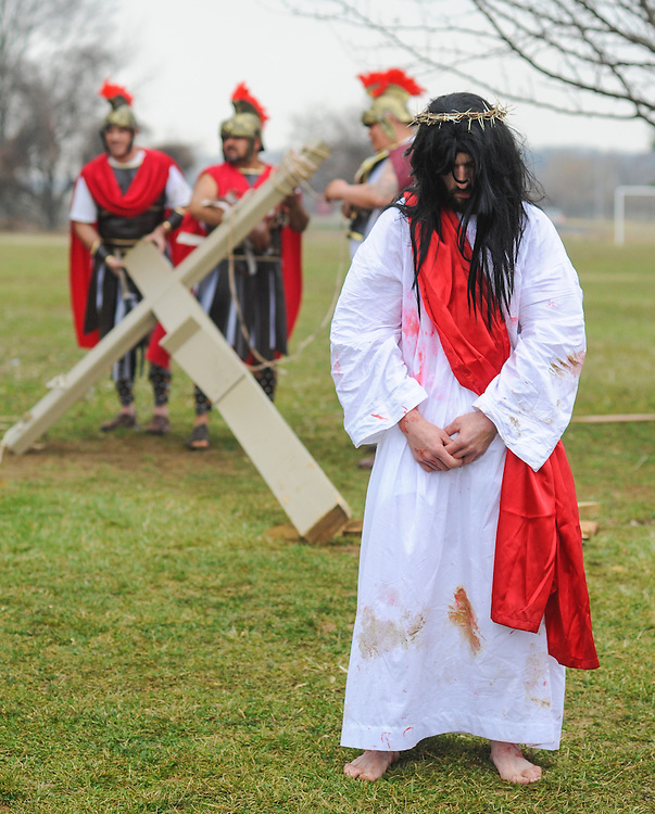 Roberto Marquez, of Bensalem, Pennsylvania portrays Jesus as he awaits during the Stations of the Cross leading to his crucifixion on Good Friday April 3, 2015 at Our Lady of Fatima in Bensalem, Pennsylvania.  (Photo by William Thomas Cain/Cain Images)