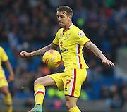 MK Dons midfielder Carl Baker volleys a pass during the Sky Bet Championship match between Brighton and Hove Albion and Milton Keynes Dons at the American Express Community Stadium, Brighton and Hove, England on 7 November 2015. Photo by Bennett Dean.