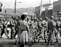 Woman in central Berkeley as National guard troops take over the town during People's Park Student protest & riots in Berkeley California 1969