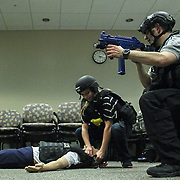 Master Sergeant Adam B. Ringle (RIGHT) and registered nurse Jennifer Parave (LEFT) attaches a Tactical Tech Rescue Device to a life like mannequin during a secure and rescue scenario in the course of an Active Shooter workshop Sunday, Mar 16, 2014 Christina Hospital in Newark Delaware.