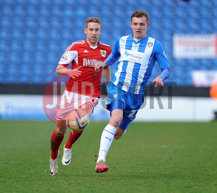 Bristol City's Scott Wagstaff chases down Colchester United's Alex Gilbey - Photo mandatory by-line: Dougie Allward/JMP - Mobile: 07966 386802 22/03/2014 - SPORT - FOOTBALL - Colchester - Colchester Community Stadium - Colchester United v Bristol City - Sky Bet League One