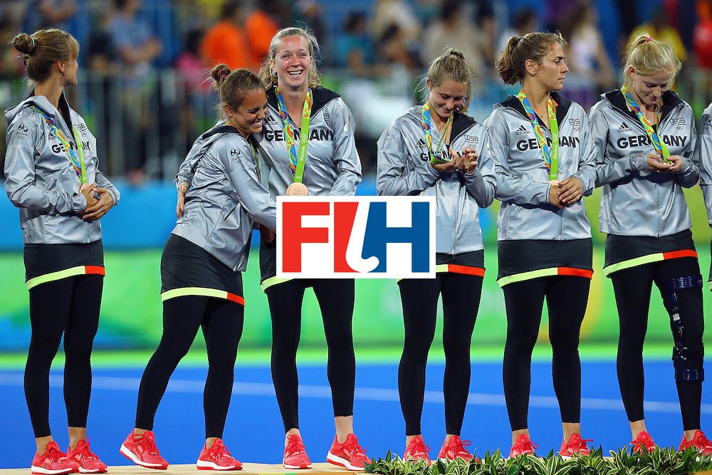 RIO DE JANEIRO, BRAZIL - AUGUST 19:  Germany players react on the podium during the medal ceremony for Women's Hockey after winning bronze medals on Day 14 of the Rio 2016 Olympic Games at the Olympic Hockey Centre on August 19, 2016 in Rio de Janeiro, Brazil.  (Photo by Tom Pennington/Getty Images)