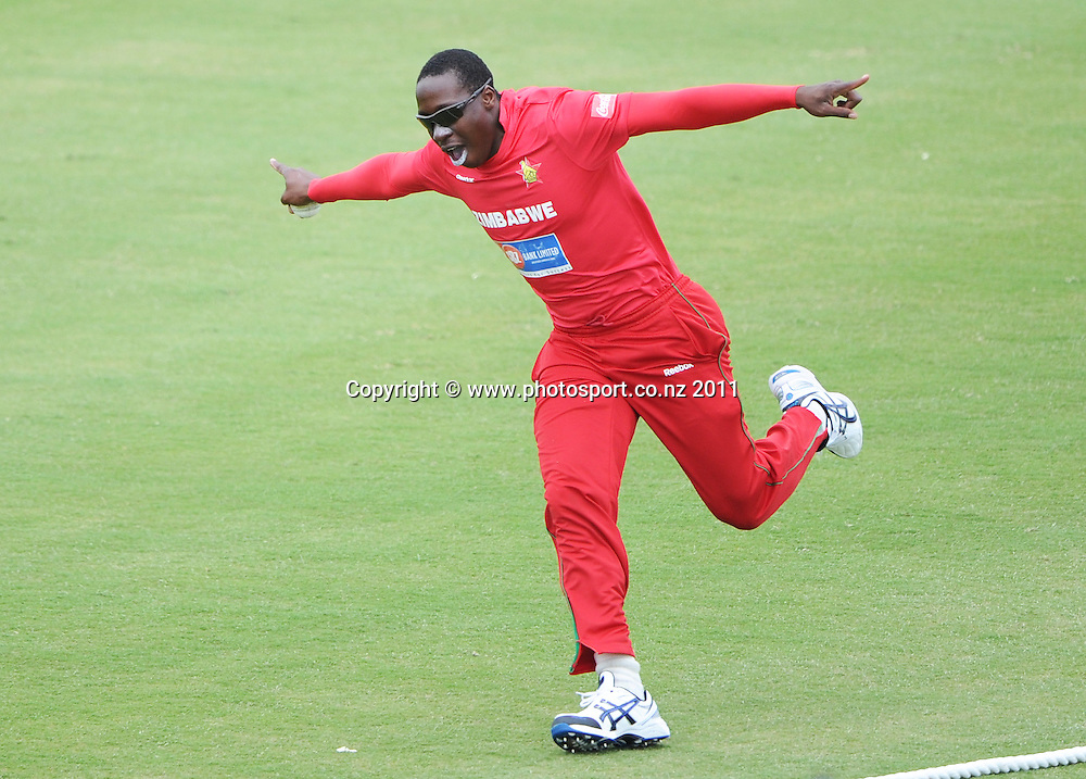 Shingi Masakadza celebrates after taking a catch to dismiss Martin Guptill at the 2nd ODI cricket match between New Zealand and Zimbabwe at Cobham Oval in Whangarei, Monday 6 February 2012. Napier, New Zealand. Photo: Andrew Cornaga/Photosport.co.nz