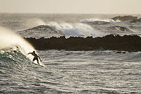 Surfer on the Pohoiki break, a popular destination for locals and tourists alike in the Puna district of the Big Island of Hawaii.