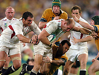 Photo: Richard Lane.<br />Australia v England. Rugby World Cup Final, at the Telstra Stadium, Sydney. RWC 2003. 22/11/2003. <br />Lawrence Dallaglio powers his way through Joe Roff and Elton Flatley with Martin Johnson in support.