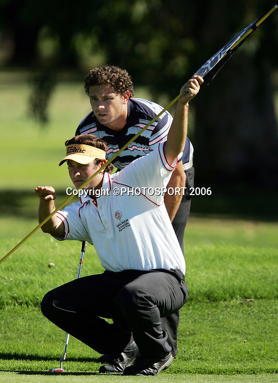 Russley's Tyrone Nelson and his caddy David Norquay discuss a putt during Nelson's match against Springfield's Mark Smith in the 2006 New Zealand Mens Golf Amateur Championship at Coringa Golf Course, Christchurch, on Friday 7 April 2006. Smith won the match. Photo: Tim Hales/PHOTOSPORT