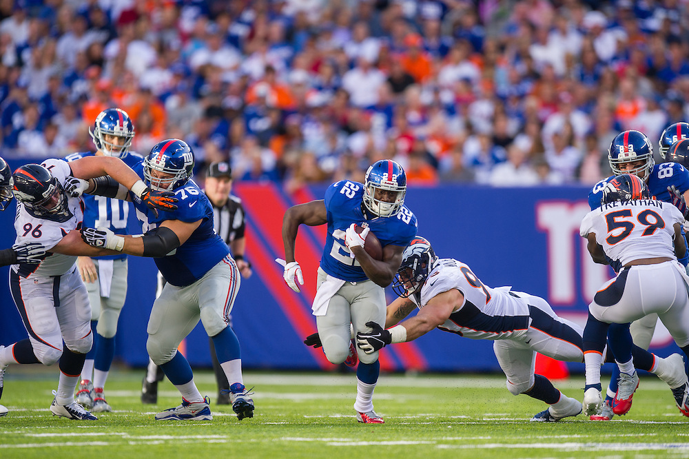 EAST RUTHERFORD, NJ - SEPTEMBER 15: running back David Wilson #22 of the New York Giants runs the ball during the game against the Denver Broncos at MetLife Stadium on September 15, 2013 in East Rutherford, New Jersey. (Photo by Rob Tringali) *** Local Caption *** David Wilson
