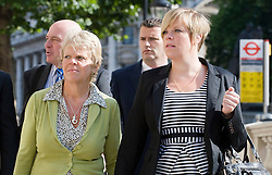 © licensed to London News Pictures. 11/07/2011. Bob Dowler (Back, left) Sally (green top) and Gemma Dowler (striped dress), the Father, mother and sister of Milly Dowler arrive at The Cabinet Office with member of the 'Hacked Off' group to meet Deputy Prime Minister Nick Clegg today (11/07/2011) to discuss the News Of The World phone hacking scandal . Photo credit should read Ben Cawthra/LNP