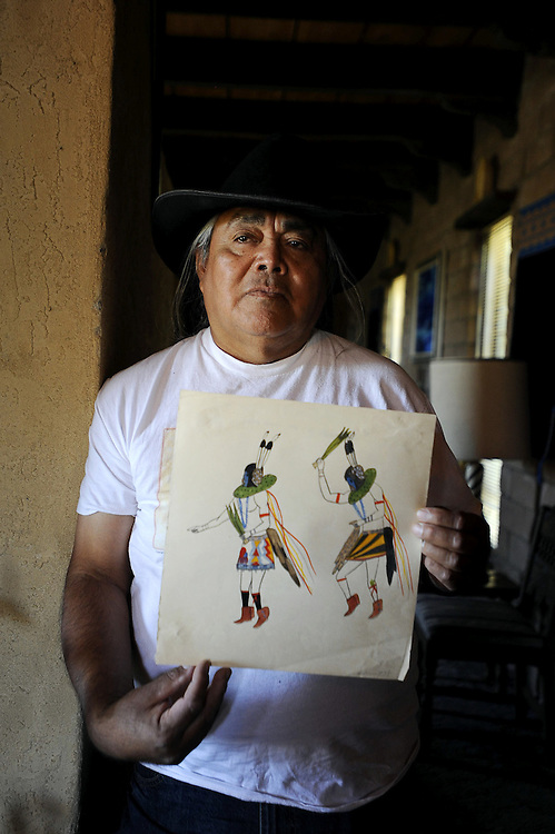 091410       Brian Leddy.Irving Toddy holds a painting by his father, Beatien Yazz, that was recently given to him. A small collection of early paintings by the well known Navajo artist from 1942 were recently discovered and donated to Toddy, who is also a well known painter.