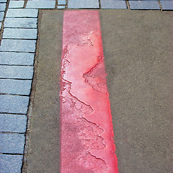 """The well worn red line path of Boston's """"Freedom Trail"""" near the Old State House Buiding, Boston, MA"""