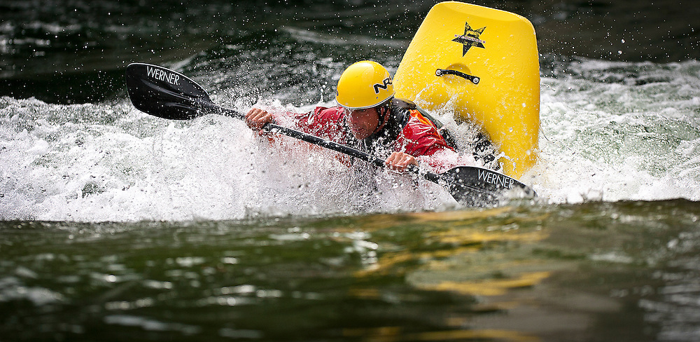 "Jud Kaiser of Liberty Lake, Washington prepares to front flip out of the water at the popular kayaking spot, ""Dead Dog"" along the Spokane River near Stateline, Idaho on Wednesday."