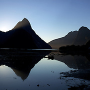 Mitre Peak is an iconic mountain in the South Island of New Zealand. It is one of the most photographed peaks in the country. Part of the reason for its iconic status is its location. Close to the shore of Milford Sound, in the Fiordland National Park in the southwestern South Island, it is a stunning sight. Rising to 1,692 metres from the water of the sound. it is actually a closely grouped set of five peaks, although from most easily accessible viewpoints it appears as a single point. Milford Sound,  Milford Sound, New Zealand. 29th April 2011. Photo Tim Clayton