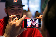 10/22/13 — BOSTON — Boston Red Sox pitcher Brandon Workman gets up close with an iPhone interview during the World Series Media Day at Fenway Park on Oct. 22, 2013.