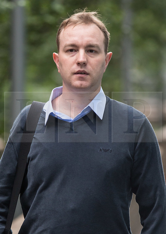 """© Licensed to London News Pictures. 07/07/2015. London, UK. Tom Hayes, the former UBS and Citigroup trader, arriving at Southwark Crown Court where he is accused of being the """"ringmaster"""" in an enormous fraud to rig the Libor benchmark interest rate.Photo credit : James Gourley/LNP"""