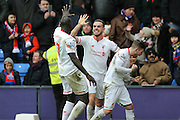 Liverpool defender Mamadou Sakho (17) , Liverpool midfielder Jordan Henderson (14)   and Liverpool defender Alberto Moreno (18)  celebrate Liverpool forward Christian Benteke (9)  goal that wins the game for Liverpool  during the Barclays Premier League match between Crystal Palace and Liverpool at Selhurst Park, London, England on 6 March 2016. Photo by Simon Davies.