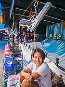 "27 NOVEMBER 2012 - BANGKOK, THAILAND:  A ""carny"" waits for customers at a shooting booth at the Wat Saket Temple Fair in Bangkok. Thailand is facing a rising tide of gun violence and is wrestling with how to curb it. Despite strict gun control laws, more and more guns are showing up in the country. Wat Saket, popularly known as the Golden Mount or ""Phu Khao Thong,"" is one of the most popular and oldest Buddhist temples in Bangkok. It dates to the Ayutthaya period (roughly 1350-1767 AD) and was renovated extensively when the Siamese fled Ayutthaya and established their new capitol in Bangkok. The temple holds an annual fair in November, the week of the full moon. It's one of the most popular temple fairs in Bangkok. The fair draws people from across Bangkok and spills out in the streets around the temple.   PHOTO BY JACK KURTZ"