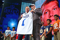 April 26, 2018 - Arlington, TX, U.S. - ARLINGTON, TX - APRIL 26: Leighton Vander Esch holds up a jersey with NFL Commissioner Roger Goodell after being chosen by the Dallas Cowboys with the 19th pick during the first round at the 2018 NFL Draft at AT&T Statium on April 26, 2018 at AT&T Stadium in Arlington Texas.  (Photo by Rich Graessle/Icon Sportswire) (Credit Image: © Rich Graessle/Icon SMI via ZUMA Press)