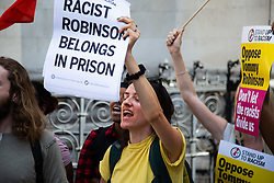 Protesters from Stand Up To Racism demonstrate outside The Royal Courts of Justice in London as an appeal by lawyers representing right wing activist Tommy Robinson win his release on bail ahead of a new hearing to be held at The Old Bailey, following his imprisonment on contempt of court charges. London, August 01 2018.