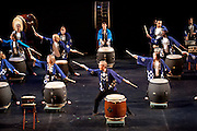 The Ohio University Taiko Ensemble performs during a dress rehearsal for the third annual Global Excusions World Music and Dance Festival, which was held in the Templeton-Blackburn Alumni Memorial Auditorium on Saturday. Photo by: Ross Brinkerhoff.