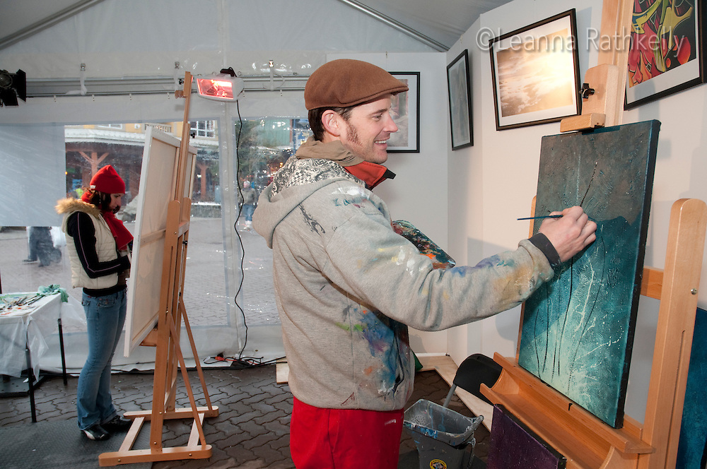 Artist Chili Thom paints during Whistler Live, a cultural program part of the 2010 Olympic Winter Games in Whistler, BC