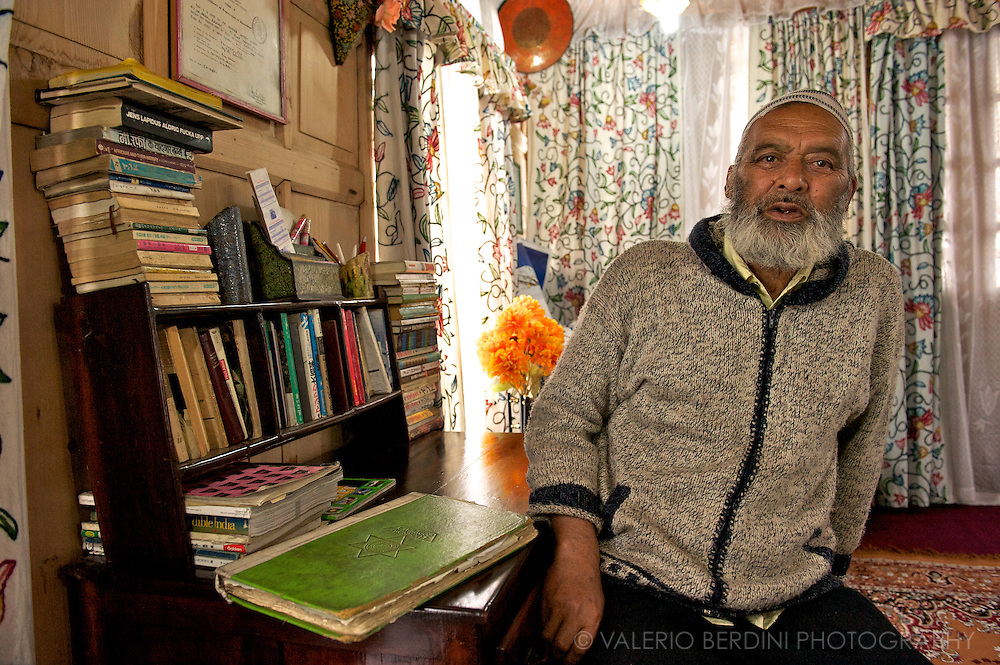 A houseboat owner shows around his decorated place in the attempt to rent me a room. Srinagar. Kashmir. India