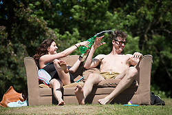 © Licensed to London News Pictures. 30/06/2015. Leeds, UK. Students enjoy the heatwave in Hyde park in Leeds. Britain is set to sizzle in temperatures of up to 34C (93F) today, with forecasters predicting the hottest day for several years. A tropical air mass moving from North Africa, Spain and Portugal means that we could be hotter than Rio de Janeiro. Photo credit : Andrew McCaren/LNP