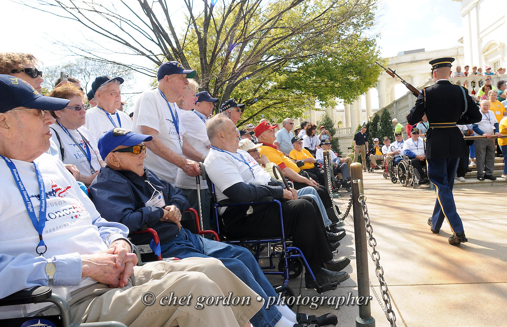 WWII Veterans onboard the Hudson Valley Honor Flight view the changing of the guard ceremony at Arlington National Cemetery in Arlington, VA on Saturday, April 26, 2014. One Hundred WWII Veterans and their escorts from the Hudson Valley region of New York toured the WWII Memorial and Arlington National Cemetery in Arlington, VA.  © www.chetgordon.com