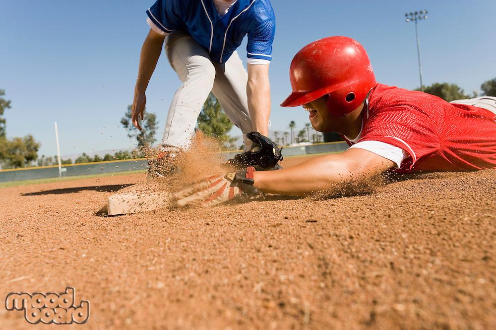 Runner and infielder reaching base