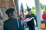 An honor guard fold the American flag during burial services with full military honors, held for 12 veterans left unattended by family or friends Thursday, August 29, 2019 at Washington Crossing National Cemetery in Washington Crossing, Pennsylvania. Once a month, burials are held for veterans who have no family and their remains have never been claimed. Some vets remains have waited 12 years for burial. (Photo by William Thomas Cain / CAIN IMAGES)