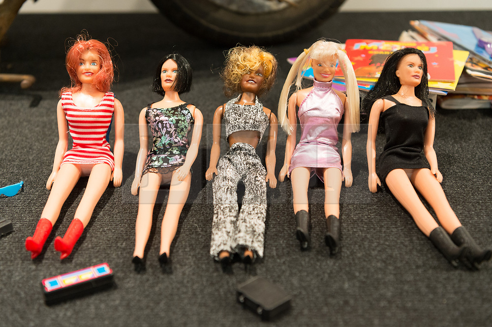 © Licensed to London News Pictures. 26/07/2018. London, UK. A selection of dolls featuring Mel B, Melanie C, Geri Halliwell, Victoria Beckham, Emma Bunton are on display at the Spice Girls exhibition. The interactive exhibition features hundreds of iconic stage, music video and film costumes worn by the popular 90s girl band at Business Design Centre/Photo credit: Ray Tang/LNP