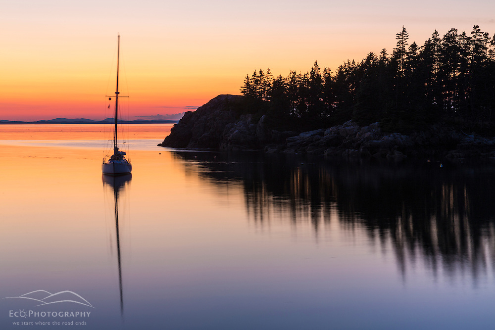 A sailboat moored in Duck Harbor on Isle au Haut in Maine's Acadia National Park. Sunset.