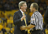 February 09 2011: Iowa Hawkeyes head coach Fran McCaffery talks with an official during the second half of an NCAA college basketball game at Carver-Hawkeye Arena in Iowa City, Iowa on February 9, 2011. Wisconsin defeated Iowa 62-59.