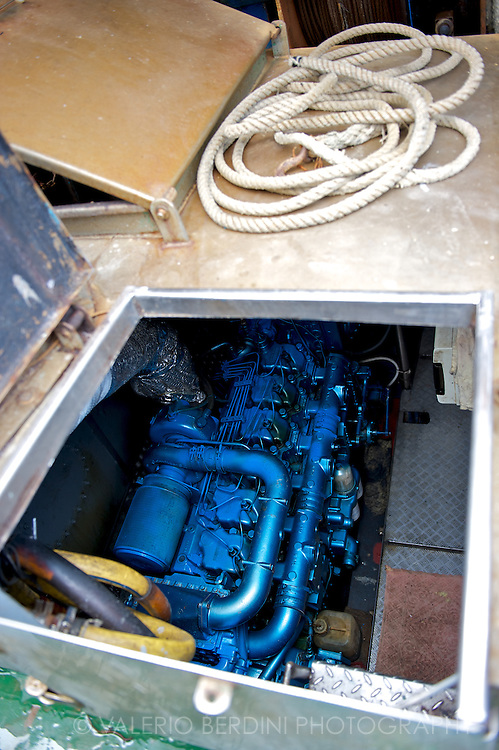The precious trawler engine is kept shiny and clean.