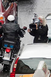 """Day two of filming. The police motorbike pass close to the cameraman on the set of the movie """"World War Z"""" being shot in the city centre of Glasgow. The film, which is set in Philadelphia, is being shot in various parts of Glasgow, transforming it to shoot the post apocalyptic zombie film.."""