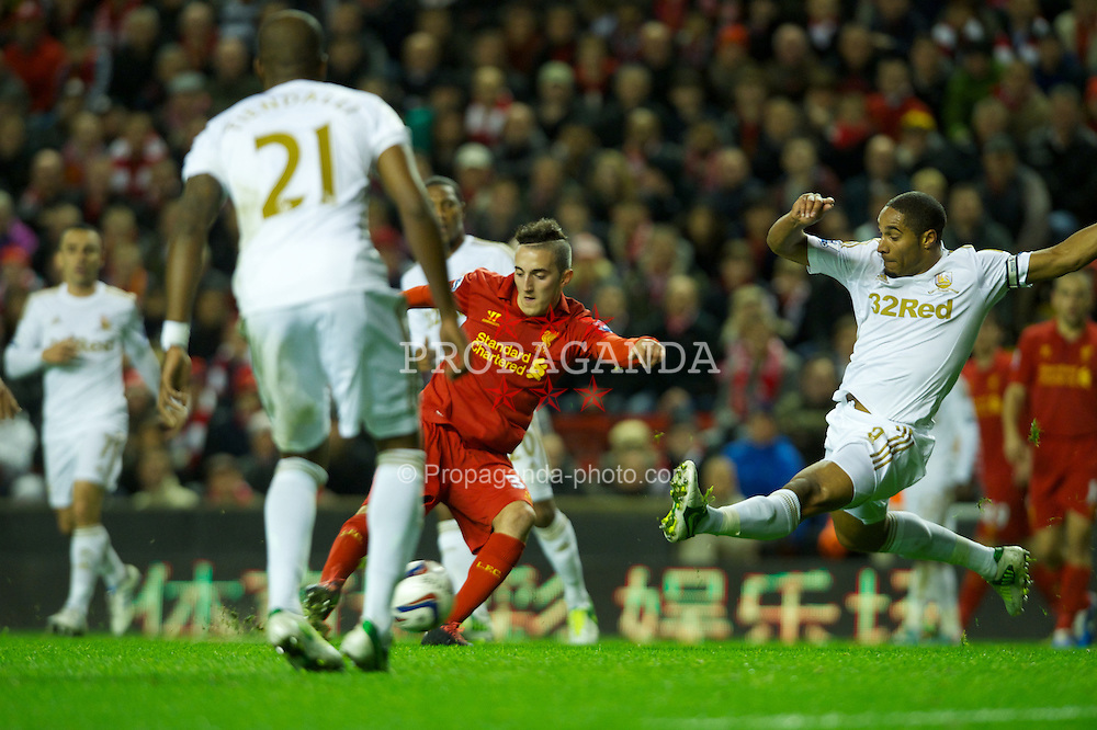 LIVERPOOL, ENGLAND - Wednesday, October 31, 2012: Liverpool's Samed Yesil in action against Swansea City's captain Ashley Williams during the Football League Cup 4th Round match at Anfield. (Pic by David Rawcliffe/Propaganda)