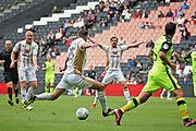 MKDons defender Callum Brittain (25) takes a shot when his team mates were screaming for a pass during the EFL Sky Bet League 2 match between Milton Keynes Dons and Exeter City at stadium:mk, Milton Keynes, England on 25 August 2018.