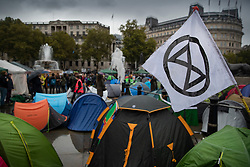 © Licensed to London News Pictures. 12/10/2019. London, UK. Tents fill Trafalgar Square as Extinction Rebellion activists continue their protests in central London after being moved by police from all other Westminster locations. XR activists calling on the government to act now on climate change have been protesting in the capital for six days. Photo credit: Peter Macdiarmid/LNP