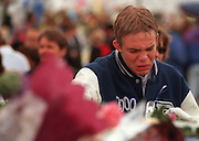 RMN182-4/25/98--Denver Christian Academy student Adrian Joel becomes overwhelmed with emotion after approaching on Sunday at Clement Park the car of his friend John Tomlin who was one of the victims on Tuesday's shooting at Columbine High School. Clement Park in Littleton, Co.  on Sunday. . --DENVER ROCKY MOUNTAIN NEWS PHOTO BY--ESSDRAS M SUAREZ---DENVER OUT--MAGS OUT--TV OUT--NO SALES