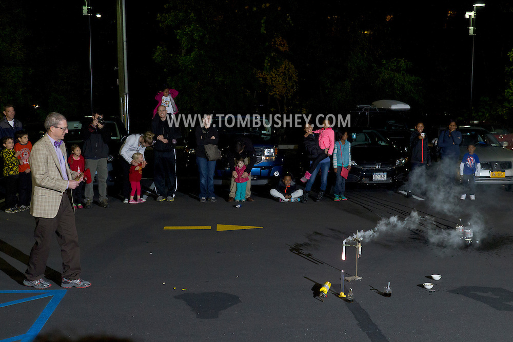 Middletown, New York  - Professor Timothy MacMahon gives a  demonstration in the parking lot during Kids Chemistry Night at SUNY Orange on Oct. 24, 2014. The program was sponsored by the college  Chemistry Club and the American Chemical Society.